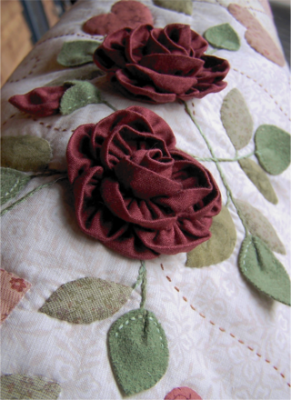 A close up As Roses Bloom Quilt ~ One Day In May Creations by Melissa Grant